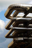 Metal oil pipe in refinery under sky Stock Images