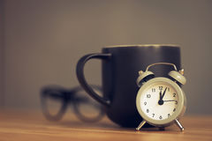 metal old alarm clock with coffee cup Stock Images