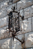 Metal old lantern on stone wall in Dubrovnik Stock Images