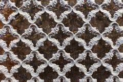 Metal openwork lattice. Vintage metal openwork grille in gray, abstract background Royalty Free Stock Photos
