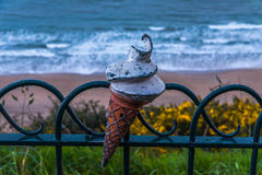 Metal ornament on a balustrade in a seaside village, a symbolic Stock Image