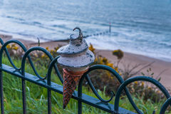Metal ornament on a balustrade in a seaside village, a symbolic Stock Photography