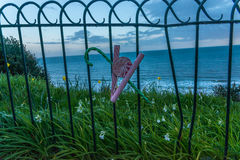 Metal ornament on a balustrade in a seaside village, a symbolic Royalty Free Stock Photo