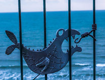 Metal ornament on a balustrade in a seaside village, symbolic in Stock Photography