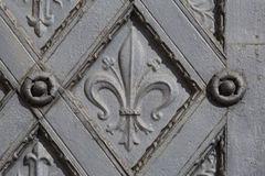 Metal ornamental door with cross and fleur de lis Royalty Free Stock Photo