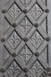 Metal ornamental door with cross and fleur de lis Stock Photo
