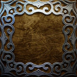 Metal ornamental frame on old wooden background . Vintage collection Stock Photos