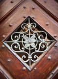 Metal ornamental pattern in wooden frame Stock Photos