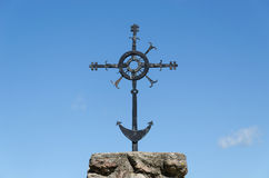 Metal ornamented cross on blue sky background Stock Photography