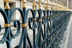 Metal ornamented fence in Paris Stock Image
