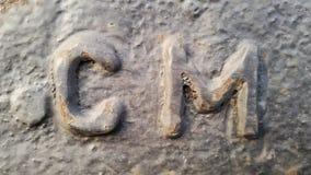 Metal ostatni CM Tekstura ośniedziały metal w postaci latter& x27; s CM Zdjęcia Royalty Free