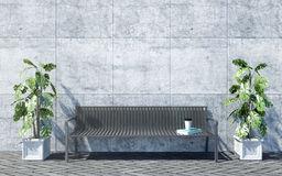 Metal outdoor bench with decorative plants on bright concrete wall background, outdoor exterior Stock Image