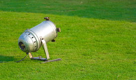 Metal outdoor light on green grass lawn royalty free stock photo