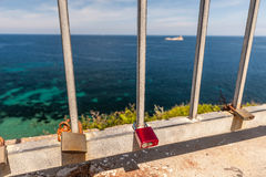 Metal padlock - memory locks on the bridge, symbol Stock Photo