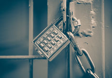 Metal padlock and pin keypad with numbers. On metal door Royalty Free Stock Image