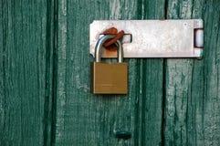 Metal padlock on wooden door Royalty Free Stock Photos