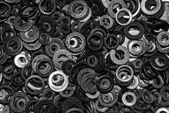 Metal washers background. Abstract background with metal circles - screw washers Stock Photos