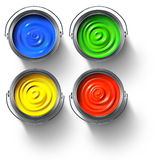 Metal paint cans. Full of red, green, yellow and blue paint Stock Image