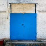 Metal painted blue door Stock Photos