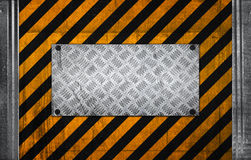 Metal panel on black yellow caution pattern Stock Photos