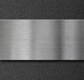 Metal panel over black plastic plate Stock Image