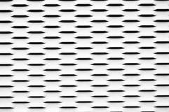 Metal panel texture. Close-up photo of a hollowed metal panel Stock Image