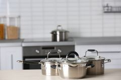 Metal pans on counter. Metal pans on kitchen counter stock photo