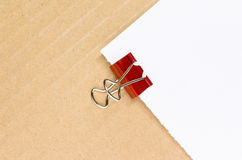 metal paper clips and blank paper Stock Photo