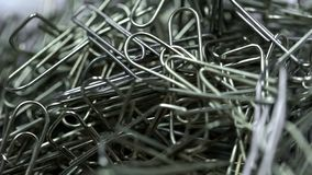 Metal paper clips stacked up extreme closeup, office supplies, unorganized group. Stock photo royalty free stock image