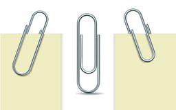 Metal paperclip and paper Stock Images