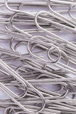 Metal paperclips background Stock Images