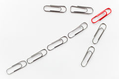 Metal paperclips, shape of arrow up, red on top Stock Photo