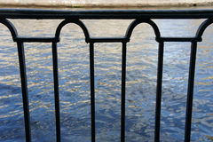 Metal parapet on quay. Metal railing on the promenade, view of water Stock Photo