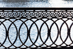 Metal parapet on waterfront Stock Images