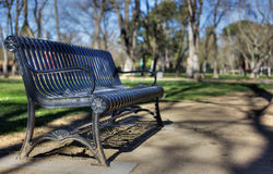 Metal park bench deeper dof Stock Photos