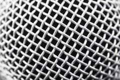 Metal microphone. Metal part of the microphone grill for getting a good clean sound and vocals, closeup stock photography