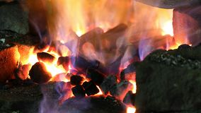 Heating of metal parts in blacksmith furnace stock video footage