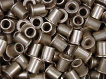 Metal parts with holes. Metal bushings with hole bulk quantity Royalty Free Stock Photos