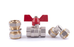 Metal parts for sanitary equipment and ball valve. Metal parts for sanitary equipment and ball valve on a white background Royalty Free Stock Images