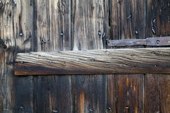 Metal Parts on Wooden Planks. Door Hinge Royalty Free Stock Photography