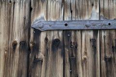 Metal Parts on Wooden Planks. Door Hinge stock photo