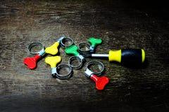 Metal patka z kolor rękojeścią dla gumowej tubki i śrubokrętu Obraz Royalty Free