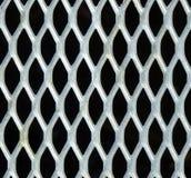 Metal pattern. Seemless pattern, metallic lattice over black backgorund royalty free stock photos