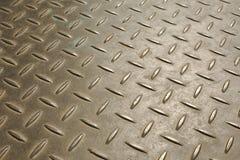 Metal pattern. Bumpy metal pattern at angle stock images