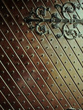Metal pattern on wooden plate Royalty Free Stock Images