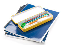 Metal pencil case and book Stock Photos
