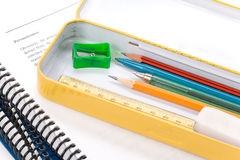 Metal pencil case and book Royalty Free Stock Image