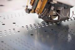 Metal perforating industrial machine. Stock Image