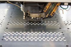 Metal perforating industrial machine. Stock Images