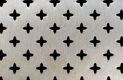 Metal perforation of a cross pattern. Texture Royalty Free Stock Photo